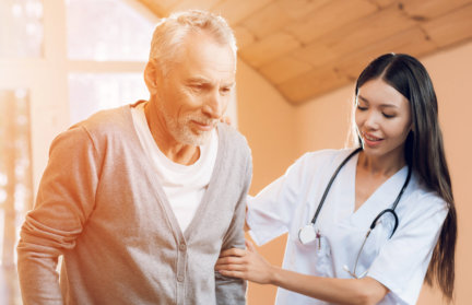 young nurse helping a senior man