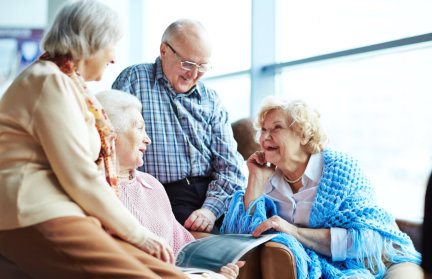 four elderly enjoying each others company