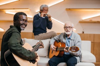 three senior men playing music instrument