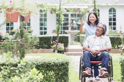 female caregiver assisting senior man