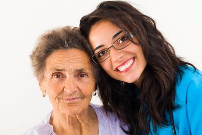 senior woman with female caregiver smiling