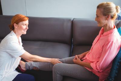woman giving light massage to senior woman